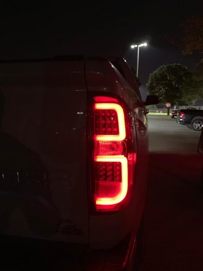 lit Toyota Tundra 14-19 LED Tail Lights in Smoked night photo