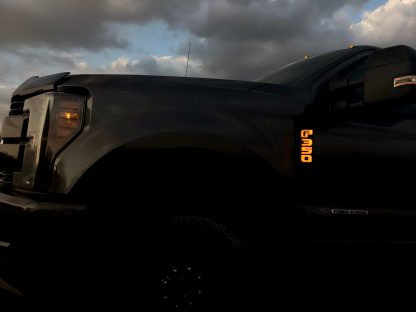 Ford F250 17-19 Illuminated Emblems Black Chrome in amber 2