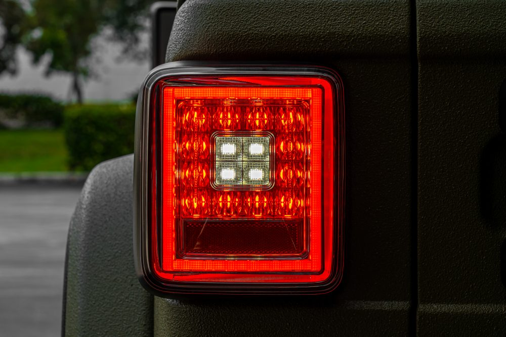 Lit photo of Jeep JL Wrangler 18-19 (for Factory OEM Halogen) Tail Lights OLED Smoked (dark)