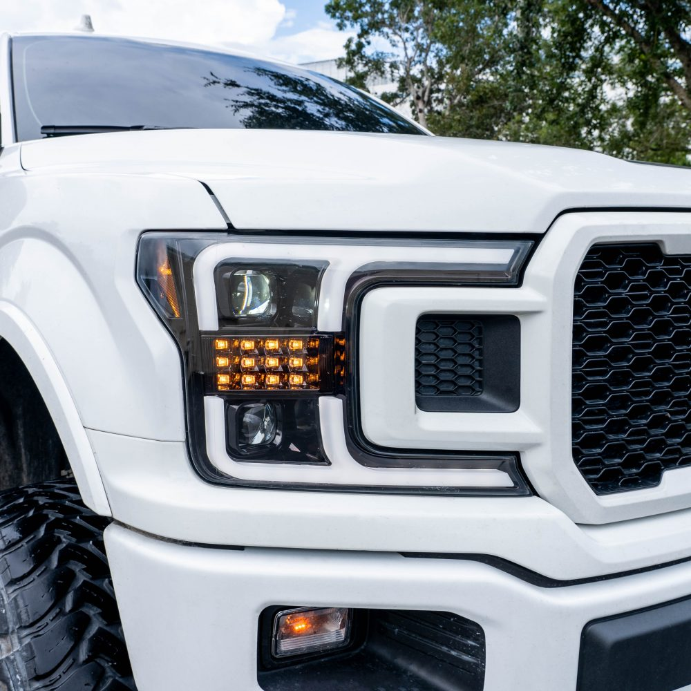 Ford F150 18-19 Projector Headlights OLED DRL, LED Turn Signals Smoked/Black angled view