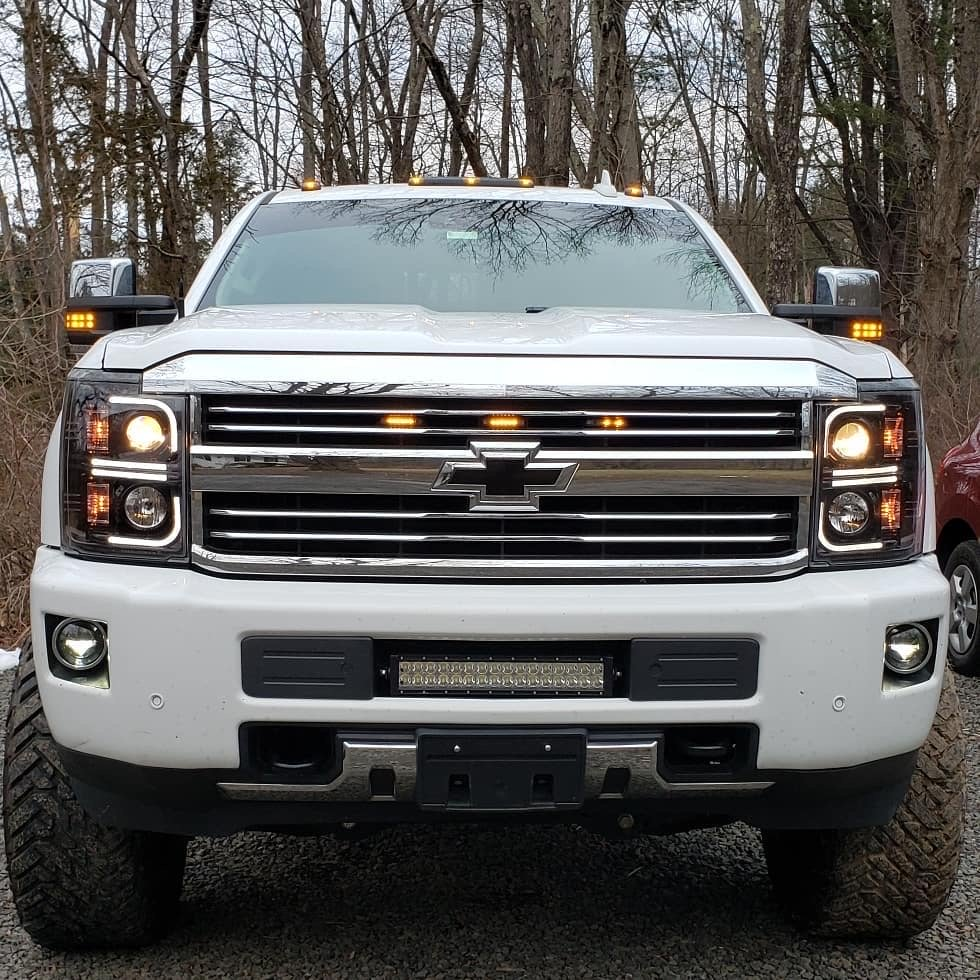RECON 264296BKC Chevrolet Silverado 2500/3500 Heavy Duty 15-19 (3rd GEN) PROJECTOR HEADLIGHTS w/ Ultra High Power Smooth OLED HALOS & DRL - Smoked / Black